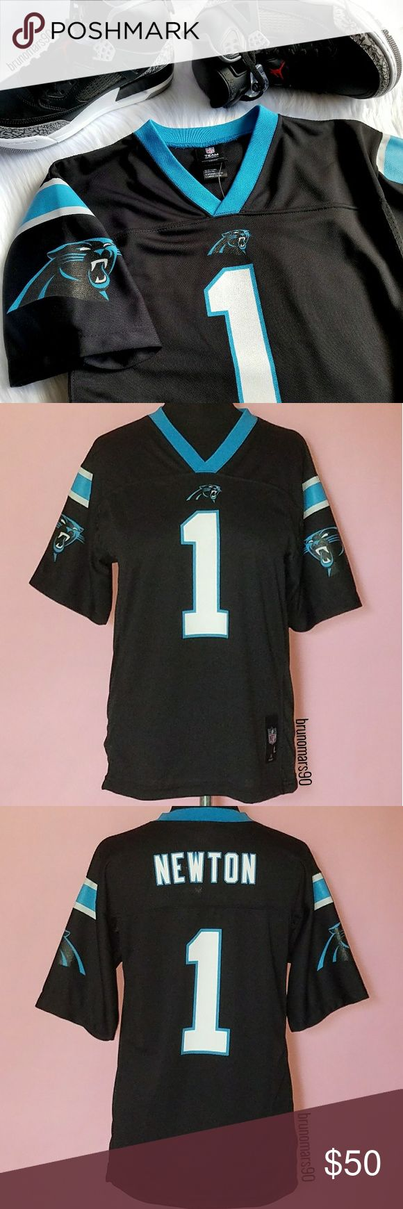 "Cam Newton NFL Jersey NWT Dab into Superman's gear. Show them your #1 everytime you wear this officially licensed Carolina Panthers Cam Newton jersey. Features team & player graphics, mesh side panels, woven jock tag, v-neck, and short sleeves. Measures 26"" from top to hem, 18"" from underarm to underarm, 9"" sleeve from shoulder. 100% Polyester. Size is L Youth. Will fit a Women's size S. No trades. NFL Shirts & Tops"