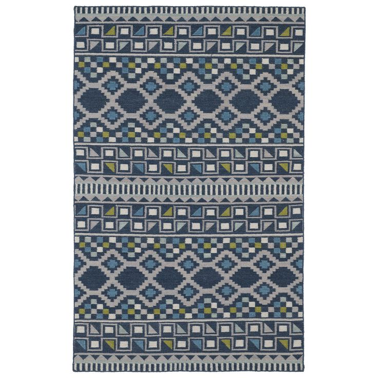 Spice up your home decor with this unique flatweave rug. With hand finished 100 percent wool details, this blue rug features a bold tribal pattern that will add a bright pop of color to any room.