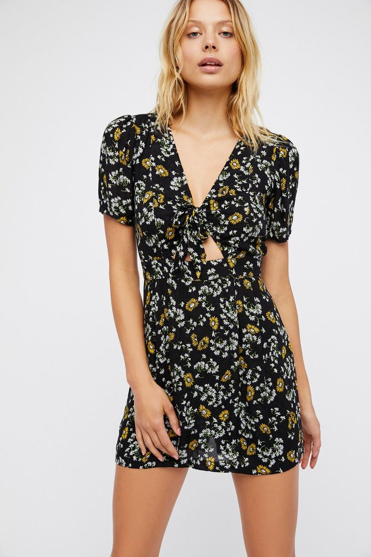 Jinx Tie Romper | In a ditsy floral print this super mini dress features built-in shorts for an effortless look.  * Front tie detail with cutout  * Femme flutter sleeve * Hidden back zip closure