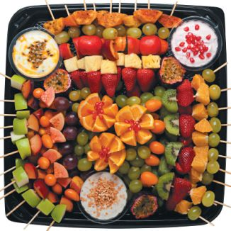Checkers & Checkers Hyper Fruit Platter - fresh fruit skewers served with a selection of yoghurts. Fruits may vary due to seasonal availability (R260).