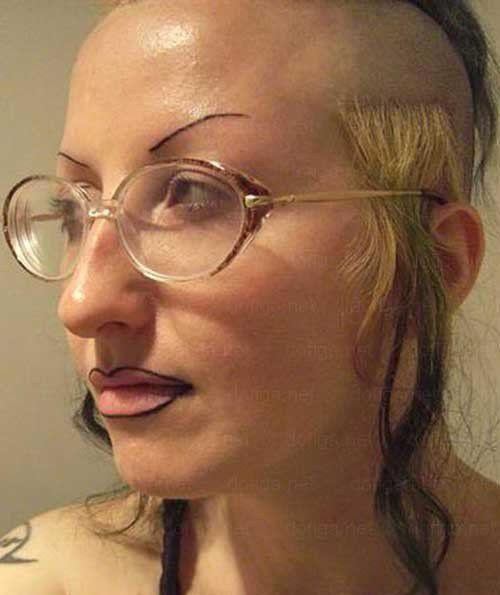 Weird eyebrows are not a surprise for this woman. Her creatively shaved head made sure of it.