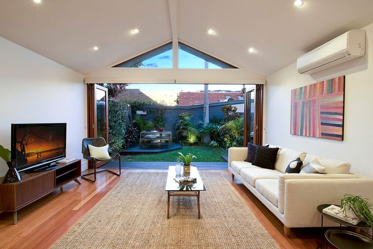 Bright interiors, high ceilings, timber floors, under stair storage R/c air-con, ceiling fans, gas heating bayonet
