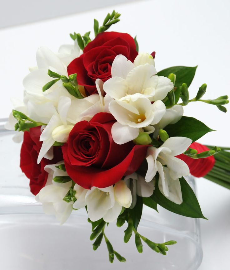 This bouquet has three sensational roses surrounded by beautiful mixed greenery and matching ribbon.