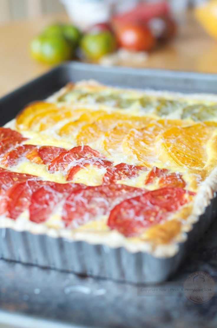 When the garden or the farmers market is bursting with summer fresh tomatoes you need to make this delicious summer tomato tart. Use a variety of tomatoes for a beautiful rainbow of of tomato colors!