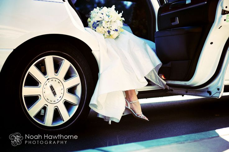 Pre-Ceremony: Bride in the limo. (by Noah Hawthrone)