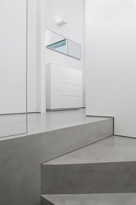 staircase corner - white and grey modern home #concrete #microtopping http://www.idealwork.com/Micro-Topping-Features-and-benefits.html