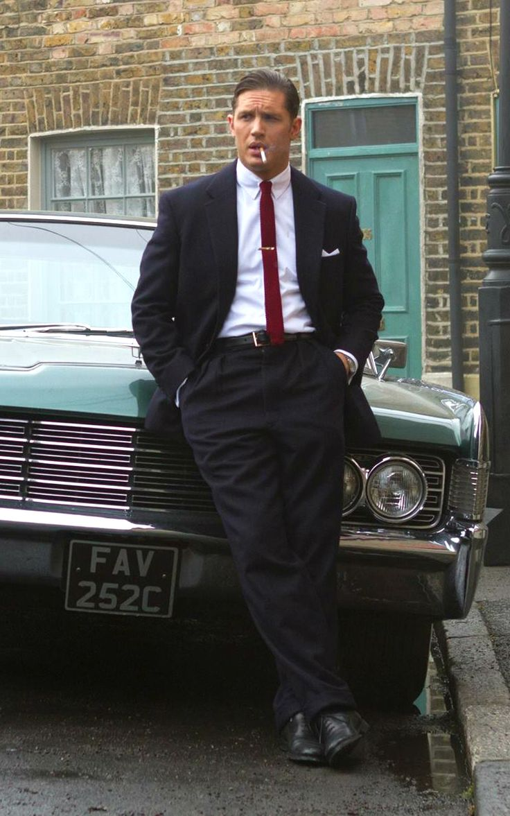 """"""" With his swept-back hair, shining eyes and full, sensual lips, Hardy as Reggie is silk and steel, dazzling to behold. """" - Tom Hardy as Reggie Kray, described by Total Film. Photo from here."""