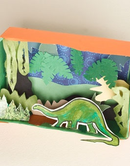 dino diorama -Remember making these as kids? D. has still not made an old fashioned shoe-box diorama...
