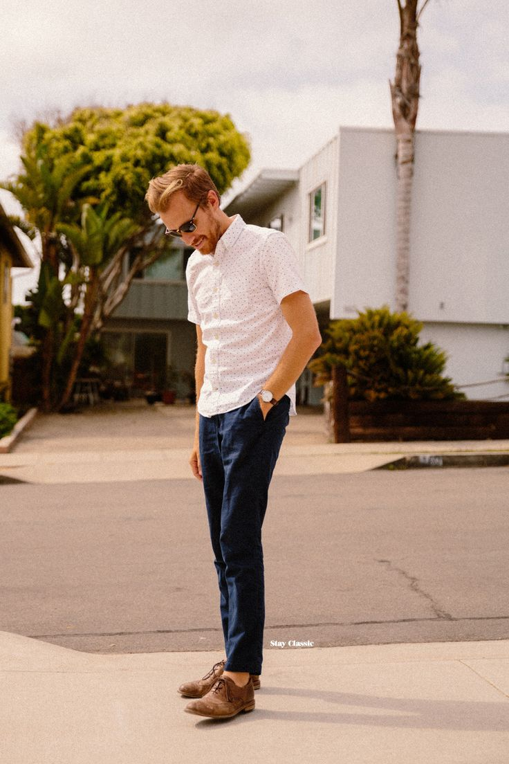 The versatility of a white polka dot short sleeve shirt and deep blue chino pants makes them investment-worthy pieces. Brown leather oxford shoes will bring a classic aesthetic to the ensemble.   Shop this look on Lookastic: https://lookastic.com/men/looks/white-polka-dot-short-sleeve-shirt-navy-chinos-brown-leather-oxford-shoes/20894   — White Polka Dot Short Sleeve Shirt  — Navy Chinos  — Brown Leather Oxford Shoes