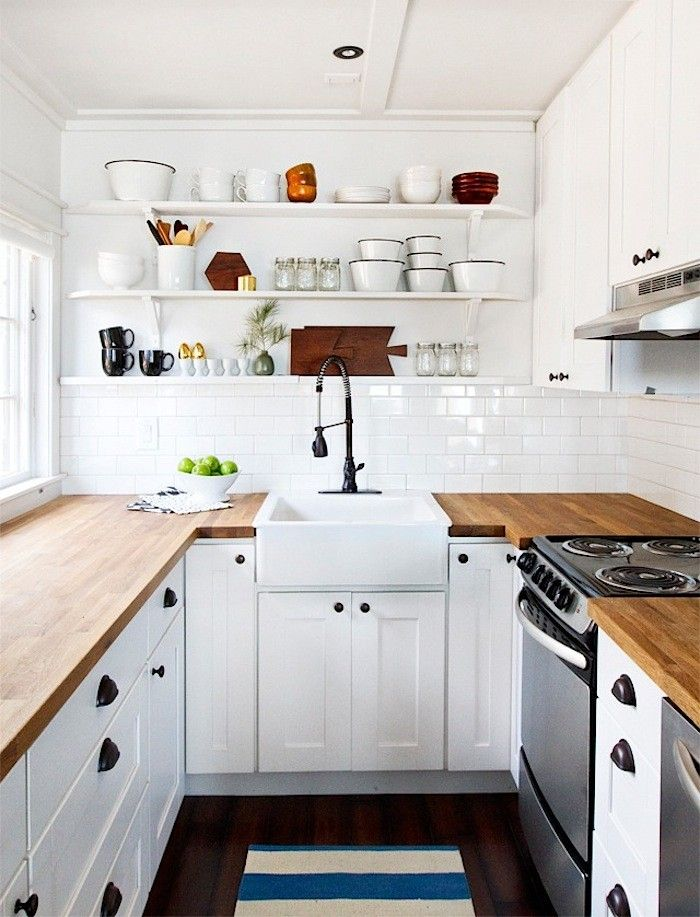 Smitten Studio Butcher Block Countertops, Remodelista. All white kitchen, farmhouse sink, subway tiles, white cabinets, open shelves. So many trends in one kitchen!