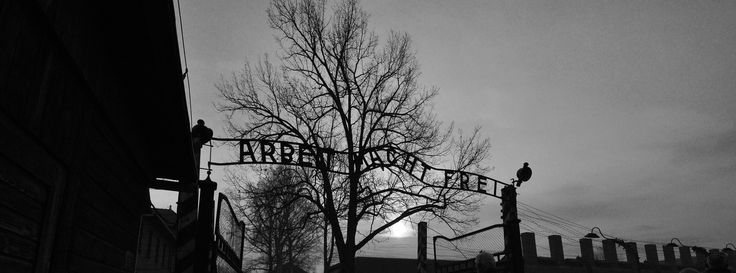 The main gate of the Auschwitz I camp. On the right - chimneys of the camp kitchen. | Auschwitz I by Aïsha Callewaert on 500px