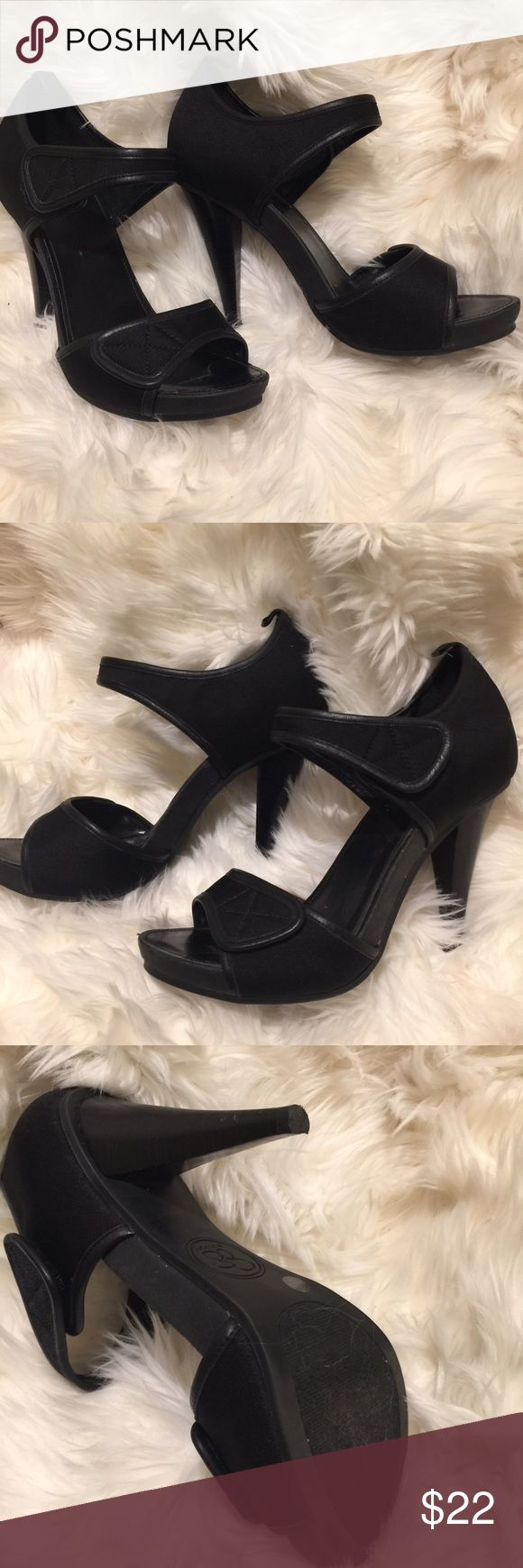 """Jessica Simpson Black Two Strap Pump Great little black pump by Jessica Simpson! The bottom strap is not adjustable and the top strap is Velcro for a sleek look without buttons or clasps. The material is something like a neoprene outer, but more sturdy and a faux leather lining. Stacked heel. Size 6.5B 4"""" heel. Good used condition, some wear to backs of heels and insoles. Overall very cute and a little different than your average black Pump! Jessica Simpson Shoes Heels"""