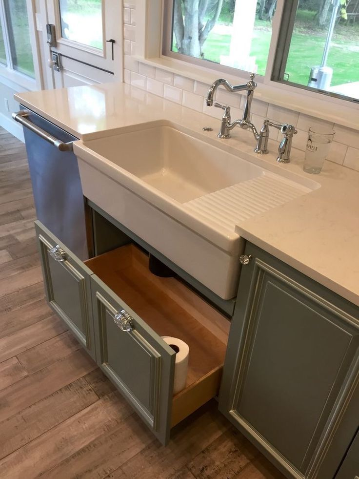 Kitchen farmhouse apron sink with drain board. Grey cabinets with under sink drawer for cleaning storage. Grey lower cabinets, white counter, hardwood floor #ad #farmhousechic #kitchencabinets