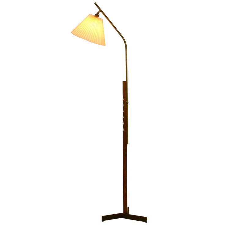 Adjustable Scandinavian Floor Lamp in Teak with Brass Detailing | From a unique collection of antique and modern floor lamps  at https://www.1stdibs.com/furniture/lighting/floor-lamps/