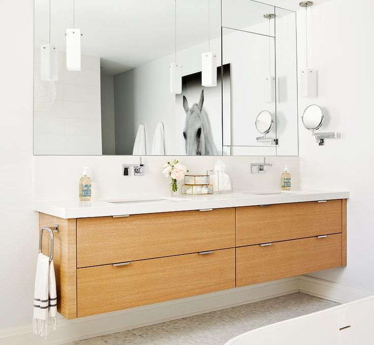 Contemporary Bathroom Features Veneer Floating Double Vanity Paired With Modern Wall Mounted Faucets And Frameless