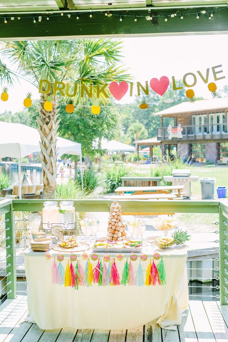 A Wekiva Island Tropical Bachelorette Bash | Wekiva Island is the perfect daytime destination for an Orlando bachelorette weekend. These ladies rented a cabana nad set up this gorgeous bachelorette dessert table with a Drunk in Love banner, pineapple banner, flamingo decorations and tons of color. Click to see the full party. Ultimate Bridesmaid | Tara Libby Photography
