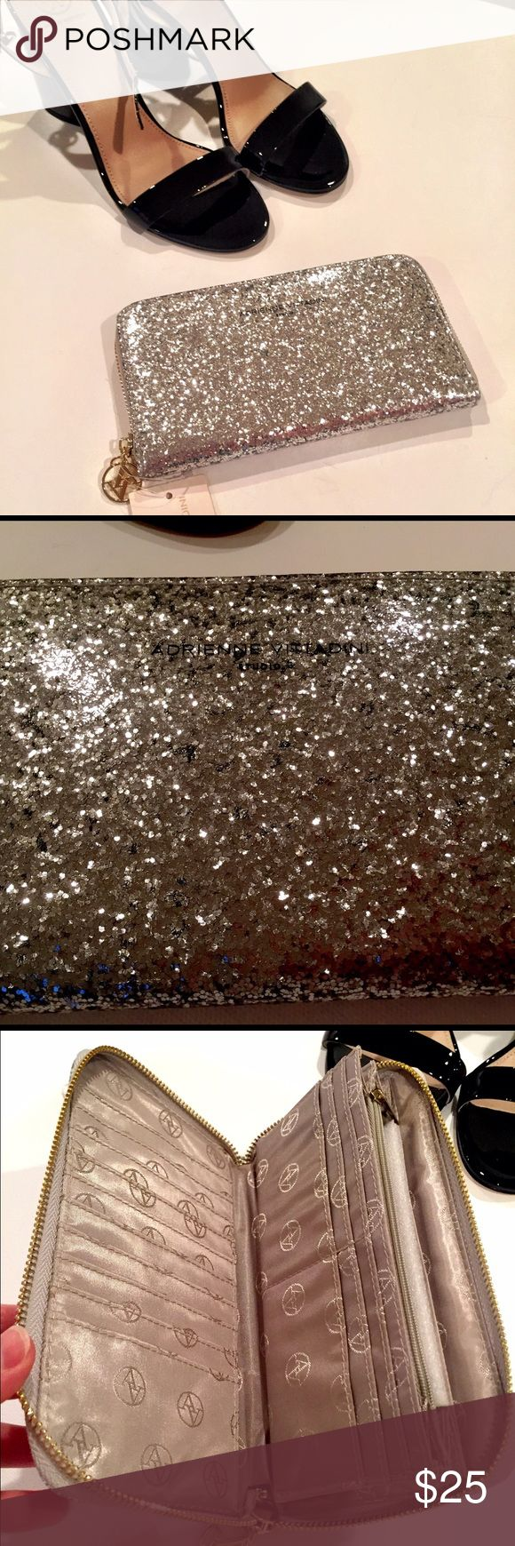 Adrienne Vittadini Glitter Wallet Business or Pleasure this slightly glamorous wallet will keep you looking sophisticated and practical! Brand New with tags! Adrienne Vittadini Bags Wallets