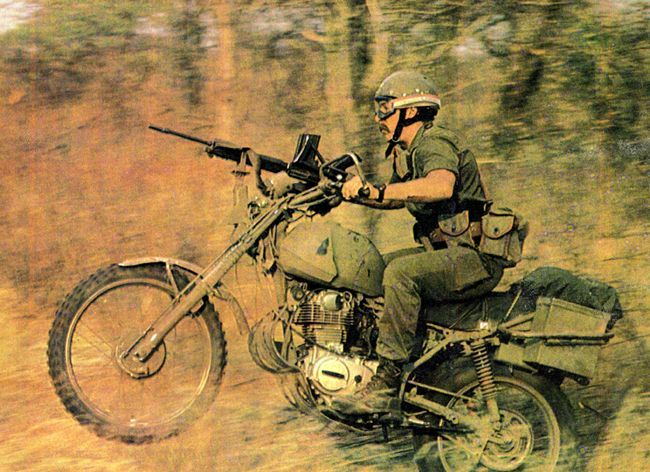 A soldier from the SWA Specialist Unit riding his bike through the bush in South Africa is seen here riding a 330cc bike in a PR exercise to highlight their new effort to fight against SWAPO. This image was found in Soldier of Fortune magazine.