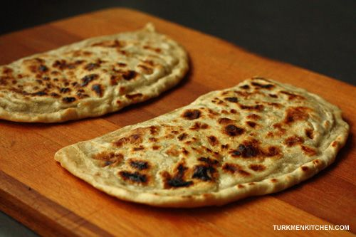 "Gyzzyrma gutap is the Turkmen name for stuffed ""half-moon"" flatbreads that are cooked in a pan over the stove. Gutap can also be baked in the oven (in this case, make the dough thicker) or deep-fri..."