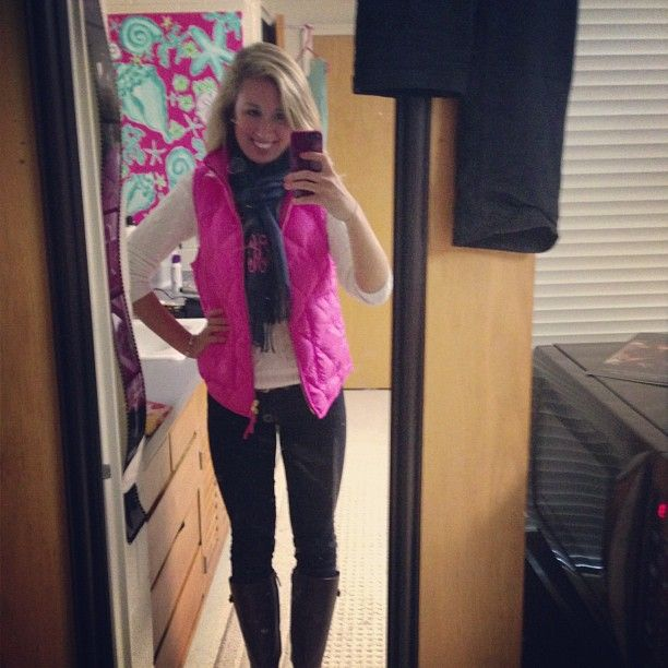 Skinny jeans, riding boots, white top, pink vest, monogrammed scarf.