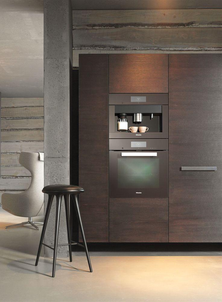 A spotlight perfectly illuminates the beautiful Miele PureLine H6860BP Oven and CVA6805 Coffee Machine in Havana Brown in this kitchen #kitcheninspiration