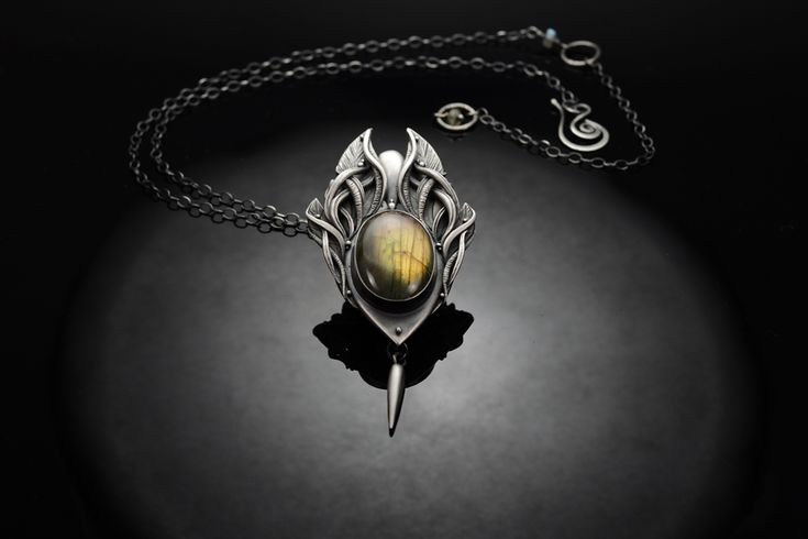 Ascension  - Fine Silver / Labradorite By Rodi Frunze. Representing the ever present soul that observes the ever changing reality through the transitions of life. Handmade from .999 fine silver, the central focus is an amazing Labradorite gemstone with a wonderful golden, green glow and light purple flashes.