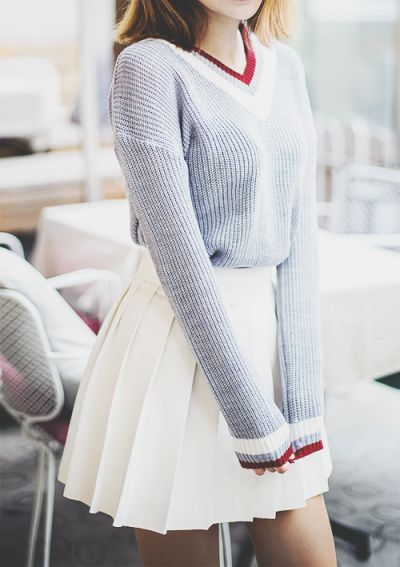Gray v neck sweater with white and maroon stripes and a white high waisted skirt