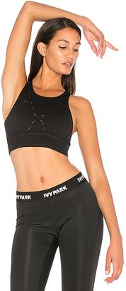 Shop Now - >  https://api.shopstyle.com/action/apiVisitRetailer?id=652020999&pid=uid6996-25233114-59 IVY PARK Denim Story Sports Bra in Black  ...