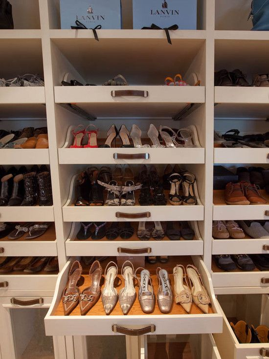 The ultimate in shoe storage and organized display. Woodmeister Master Builders. White cabinetry with wood drawer lining ...