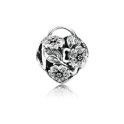 The intricate floral charm represents the padlocks used by sweethearts to symbolize their eternal love. Add it to your PANDORA bracelet as a keepsake of tender feelings. $45 #PANDORAcharm #PANDORAaw14