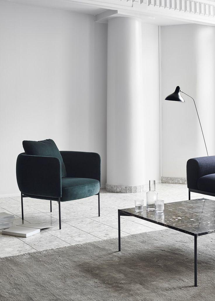 Furniture from Finnish brand Adea - minimal design - white walls - green velvet armchair