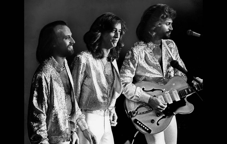 The Bee Gees included more than a dozen Top 20 hits in the 90-minute Dodger Stadium concert.