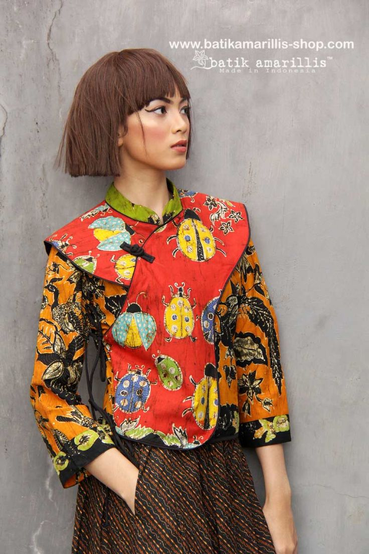 Batik Amarillis made in Indonesia proudly presents BATIK AMARILLIS's JOYLUCK Jacket 2018 in batik wonogiren beautiful reinvention of classic Qipao with quirky twists & exquisite detailing such as color combos and handmade Chinese frog button , it's absolutely unique & beautiful!