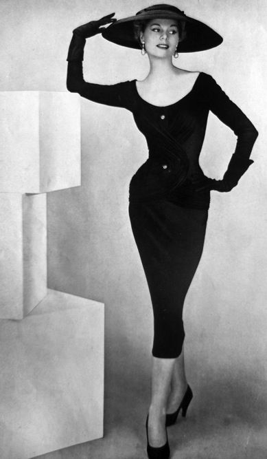 Model wearing a black ensemble for La Femme Chic, 1956.