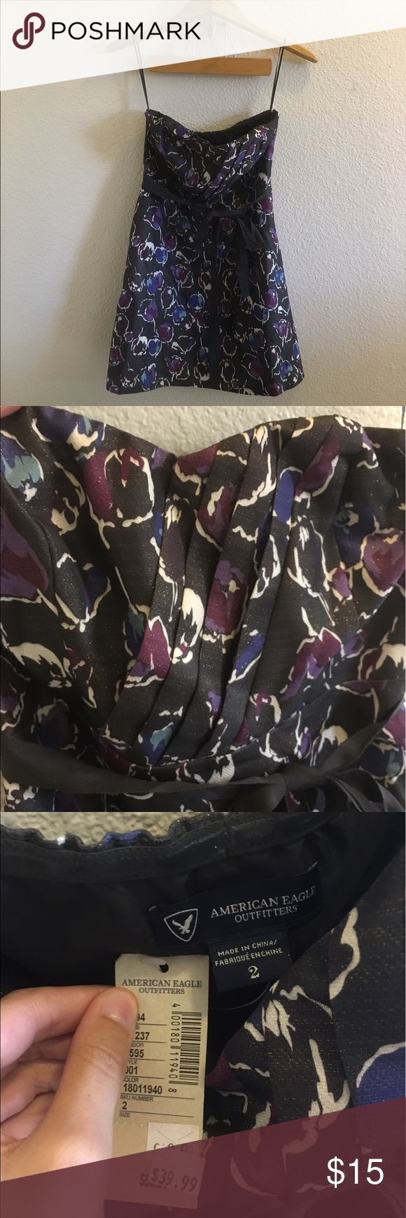 NWT Strapless Floral Dress Size 2 floral dress by American Eagle Outfitters. Dash around the waist, zips up the side. Brand new with tags. Strapless, cocktail style. I ship daily - excluding Sundays and holidays - and I store items in a smoke free, pet free environment. Open to offers; bundles discounted! American Eagle Outfitters Dresses Strapless