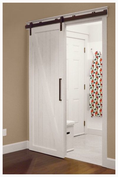 This DIY sliding barn door replaced a swinging door between the kitchen and mudroom that would hit the table in the eating area   via @Ashli @Mini Manor Blog