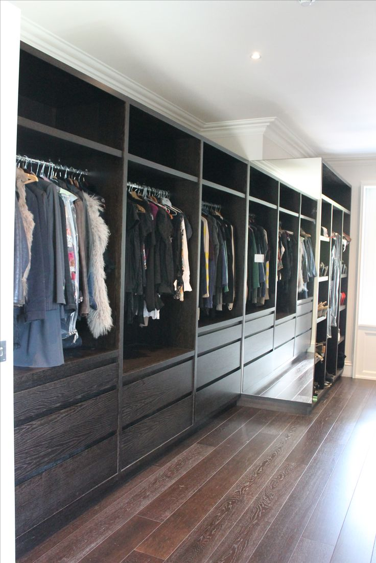 Walk-in dressing room with handle less drawers.