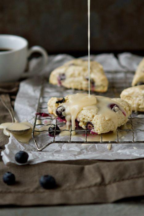 Blueberry Scones with Lemon Glaze. Tender blueberry scones flecked with lemon zest creates the perfect recipe for a breakfast treat!