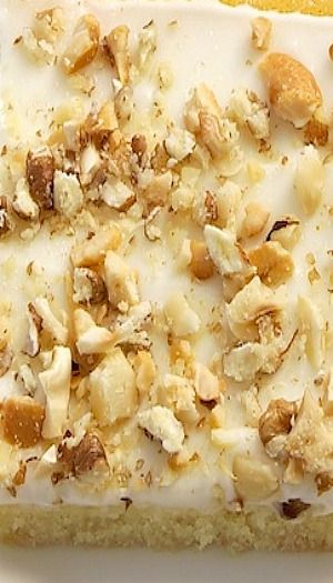 Brown Butter Texas Sheet Cake Recipe _ Adapted from Taste of the South. Put together the brown butter cake, the sour cream frosting, & a sprinkling of toasted nuts. *I used pecans, hazelnuts, & cashews!