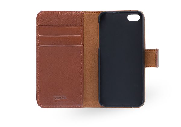 Wallet er en smart kombinasjon av lommebok og mobilbeskyttelse. Sammen med din iPhone får du tre kortlommer og en seddellomme. Dette er vegetabilsk garvet okseskinn som varer over tid. Se coverme.no
