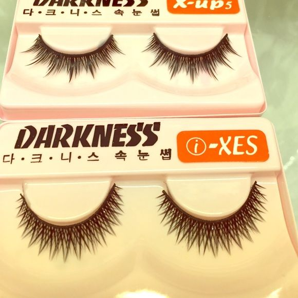2 Pairs of False Eyelashes Brand new. These cross-cross style false lashes are tangle-proof and flair out for a dramatic look. Comes with two tubes of glue inside each package. From the Korean makeup brand, Darkness. Darkness Makeup False Eyelashes