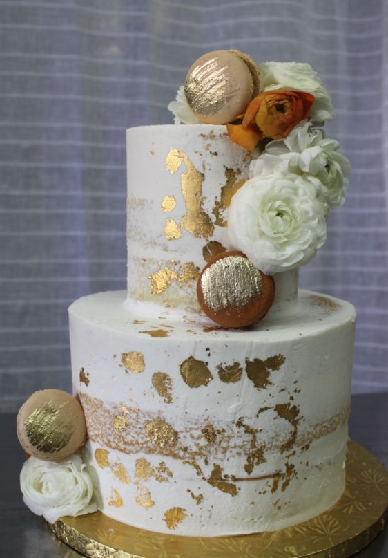Breathtaking two tier gold detailed white wedding cake; Featured Cake: Alliance Bakery