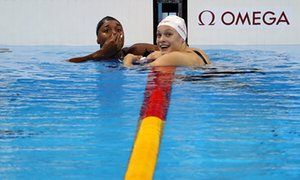 USA's Simone Manuel, left, and Canada's Penny Oleksiak celebrate winning joint gold.