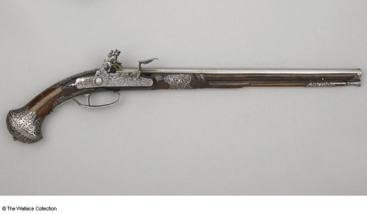 Flint-lock pistol with ramrod Attributed to Jacomo Lazarino Cominazzo (1608 - c. 1660), (barrel) Carlo Fondrini (1580 - c. 1640), (lock) Brescia, Italy c. 1645 Steel, walnut wood and silk, chiselled and engraved Length: 56.7 cm, overall Length: 38.9 cm, barrel Width: 1.3 cm, calibre Weight: 0.77 kg Inscription: LAZARINO COMINAZO Inscription: '2' Inscription: 'carlo fondrino in bressia' A1225 European Armoury III