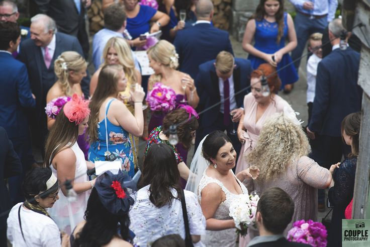 the crowd says hello to the bride.  Weddings by Couple Photography. www.couple.ie