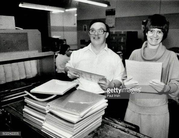 Mary Mastromatteo and Crawford Noble; employees of Central ARC Industries; stack paper into shrinking tunnels at their new workplace in Scarborough.