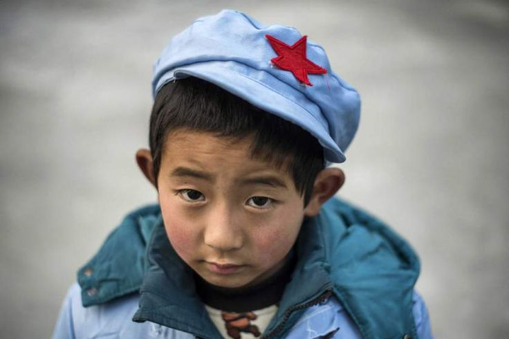 A boy waits at the Beichuan Red army elementary school. © Fred Dufour—AFP/Getty Images