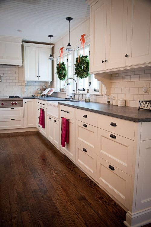 White cabinets honed slate counter tops, and black handles