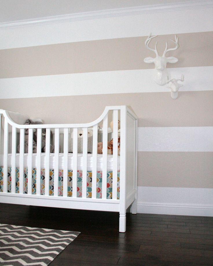 khaki and white striped nursery wall, faux animal heads, chevron rug