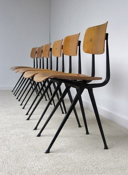 Friso Kramer chairs manufactured by De Cirkel Ahrend dating from 1963.  The chairs are made from a black folded metal structure with moulded plywood seating and back rest.